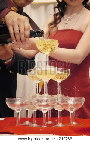 Hands pouring champagne