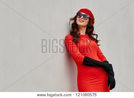 beauty young woman about the wall
