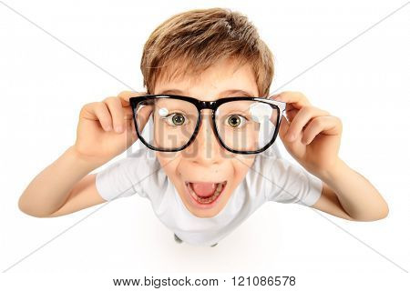 Surprised smart boy in big glasses staring at the camera. Education. Studio shot. Isolated over white.