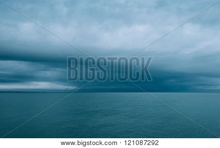 Cloudy and minimalist seascape, film emulation filter applied