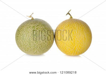 whole honeydew and galia melon with stem on white background