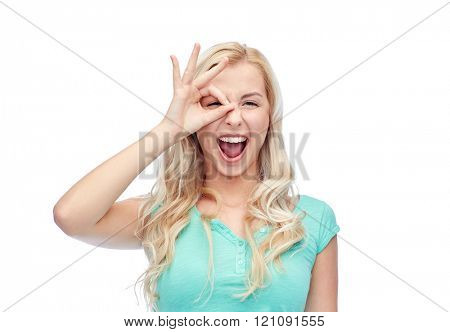 fun, emotions, expressions and people concept - smiling young woman or teenage girl making ok hand gesture