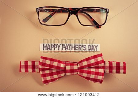 Happy fathers day sticker, bow tie, glasses on beige background