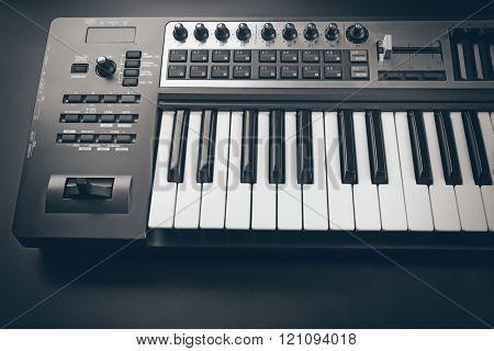 Keyboard of synthesizer on black background