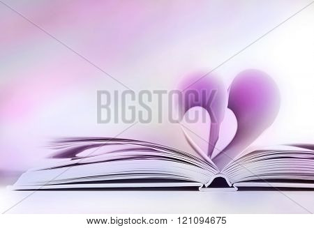 Heart from book pages on light grey background