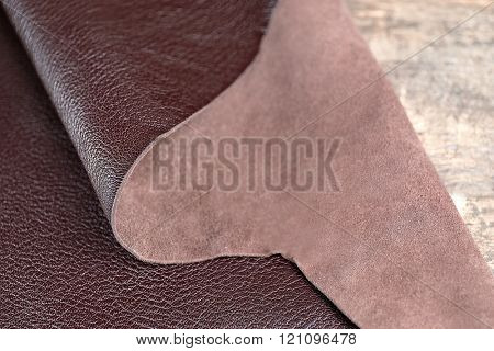 Brown leather front and wrong side on the table, close-up
