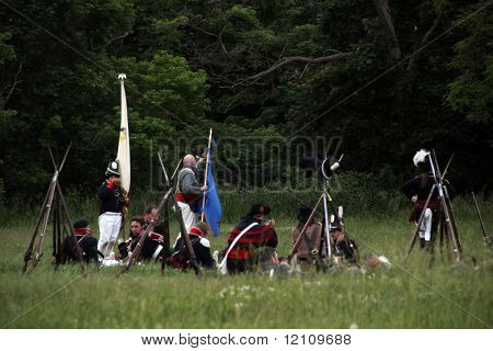 STONEY CREEK, ON - JUNE 4: American soldiers relax with their rifles before start of reenactment of the war of 1812 Battle of Stoney Creek, June 4, 2010 in Stoney Creek, ON