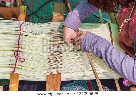 Close up shot Hands of a woman was weaving Selective focus on hand