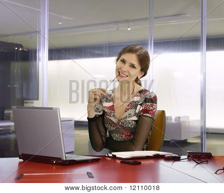 businesswoman in the office on the table