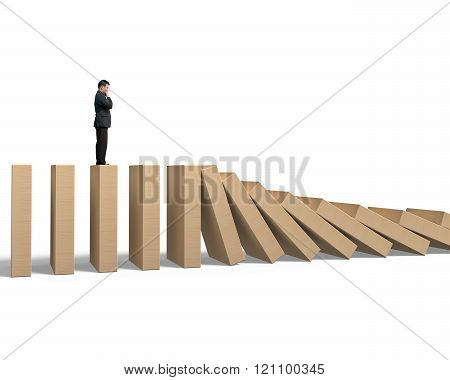 Man Standing And Thinking On Falling Wooden Dominoes
