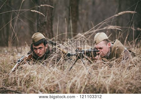 Two re-enactors dressed  as World War II Soviet russian soldiers