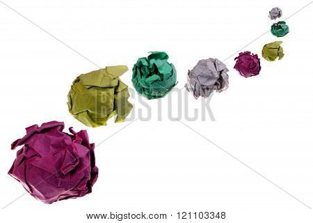 The lumps of colored paper placed in perspective, on a white background