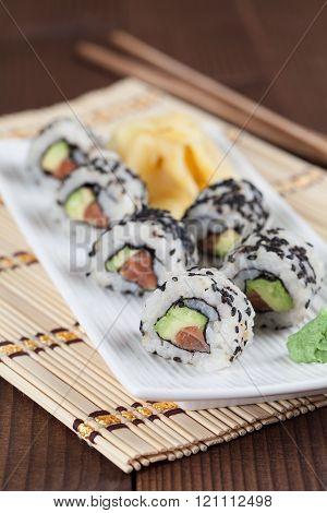 Uramaki Sushi With Avocado, Raw Salmon And Black Sesame