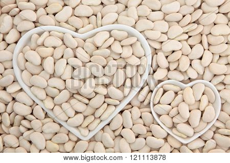 Lima bean super food in heart shaped bowls forming an abstract background.
