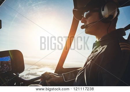 Pilot Flying A Helicopter On A Sunny Day