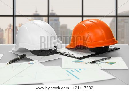 Foreman's table on city background.