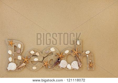 Beach sign with sea shells on sand background.