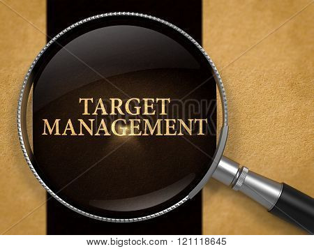 Target Management through Loupe on Old Paper.