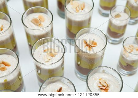 Chocolate, hazelnut and oatmeal cream sweetened with agave syrup decorated with almond slices (shallow focus)