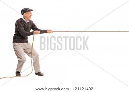 Full length profile shot of a senior gentleman pulling a rope isolated on white background