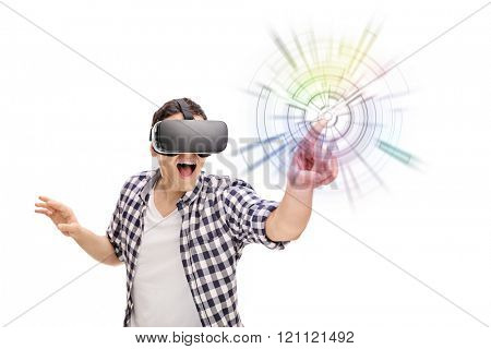 Young excited man experiencing virtual reality through VR headset isolated on white background