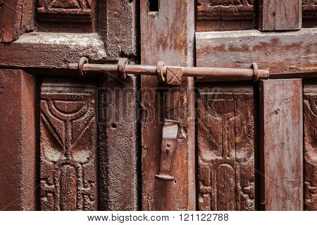 old wooden door locked on the latch