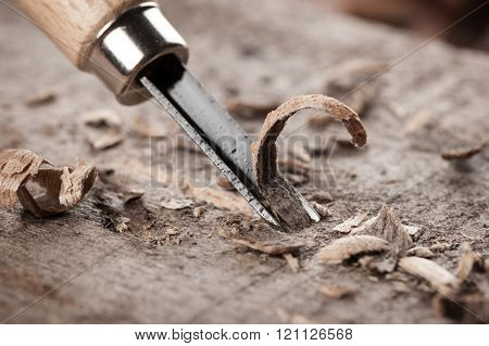 closeup chisels for wood on carpenter desktop