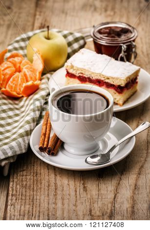 Morning cup coffeewith cake on wooden board