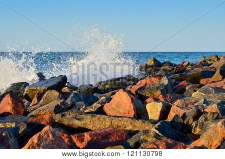 Waves Of The Sea Among The Rocks On The Beach