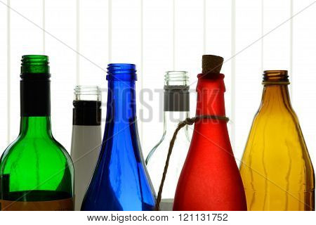 Six colorful glass bottles as decoration - close-up