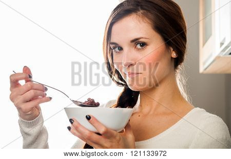 Woman With Bowl Of Coco Cereal, Homemade Breakfast