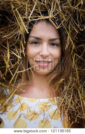 beautiful girl smiling in a dress the field