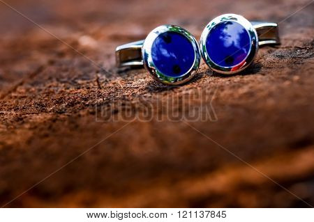 Cufflinks Blue Shirt Sitting On A Wooden Surface