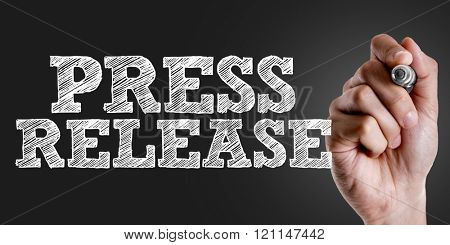 Hand writing the text: Press Release