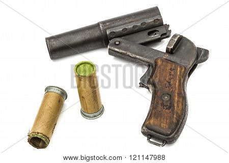 Old  signal pistol, flare gun and cartridges, isolated on white background