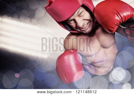 High angle view of boxer with headgear and gloves against spotlights