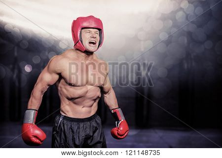 Angry boxer against black background against red boxing area with punching bags