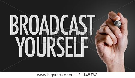 Hand writing the text: Broadcast Yourself
