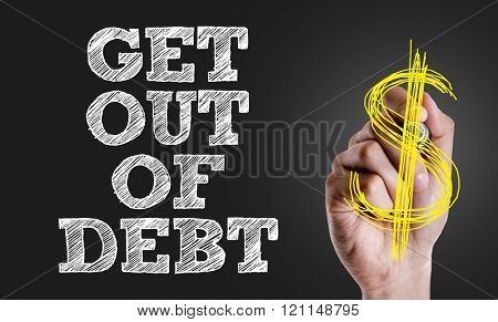 Hand writing the text: Get Out Of Debt