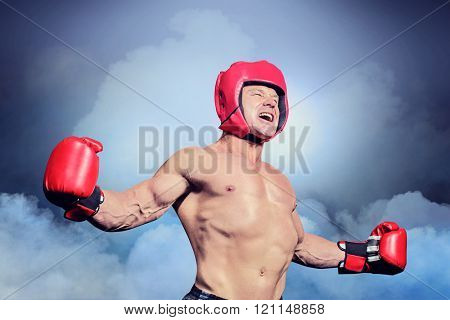 Boxer with arms outstretched against black background against cloudy sky