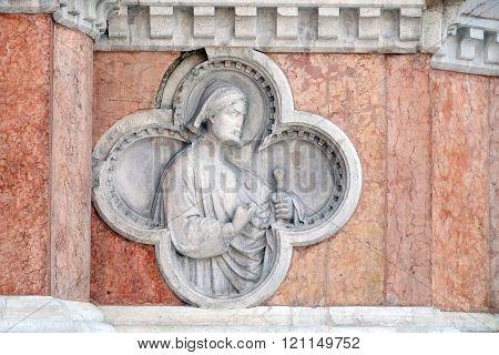 BOLOGNA, ITALY - JUNE 04: Saint Florian by Paolo di Bonaiuto relief on facade of the San Petronio Basilica in Bologna, Italy, on June 04, 2015