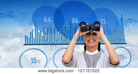 Visionary businesswoman looking through binoculars against blue data