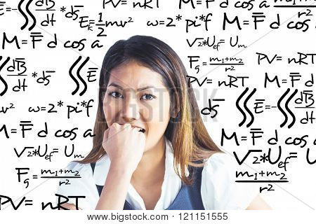 Businesswoman biting her fist against maths equation