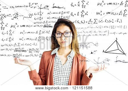 Doubtful businesswoman with eyeglasses against maths equations