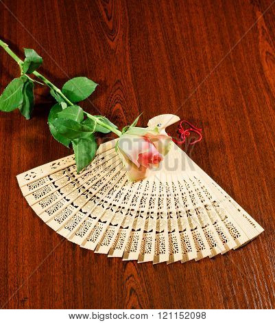Folding Carved Sandalwood Fan And Pink-white Rose.