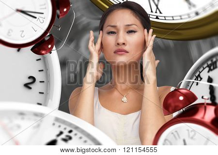 Concerned woman posing and looking at camera against black background