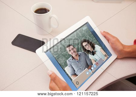 Woman using tablet pc against green