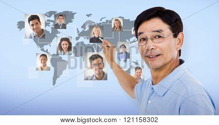 Elderly man pointing behind him against blue background
