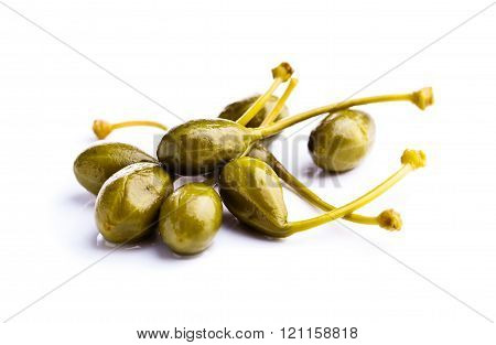 Canned Capers On White Reflective Background