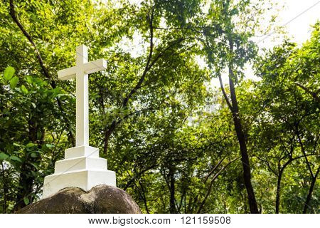 Christian cross crucifix structure stationed within greenery nature setting